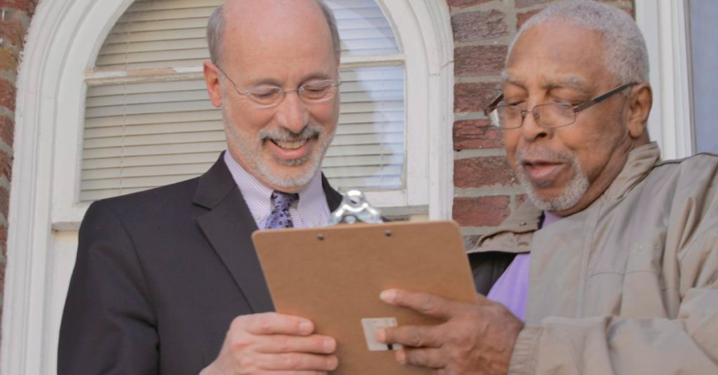 Tom Wolf and a supporter canvassing
